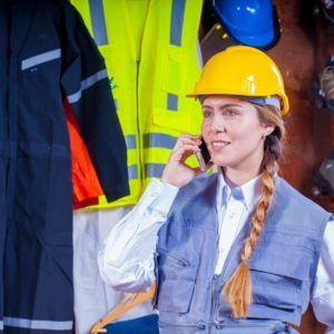 Woman in gray vest with hard hat